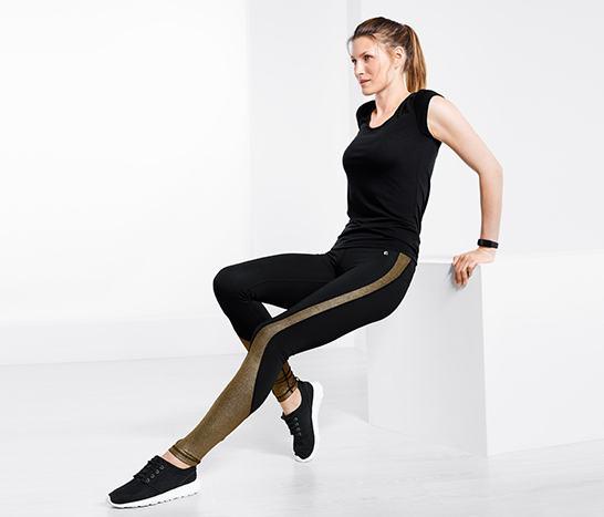 e4cdbcd82192 Az aranyszínű, csillogó betétekkel, valamint speciális szabásvonallal  készült fekete sportnadrág egyszerre biztosít nőies sziluettet, ragyogó  megjelenést, ...